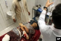 A young Afghan injured in the air strikes is treated at a hospital in the Dasht-i Archi district of Kunduz Province.