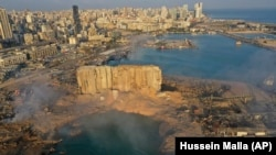 LEBANON -- A drone picture shows the scene of an explosion that hit the seaport of Beirut, August 5, 2020.
