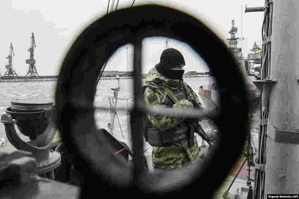 A Ukrainian serviceman stands on board a ship in the Sea of Azov port of Mariupol in eastern Ukraine. (AP/Evgeniy Maloletka)