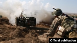 Armenia -- An Armenian soldier fires a howitzer during Russian-Armenian military exercises at the Alagyaz firing range, September 24, 2020.