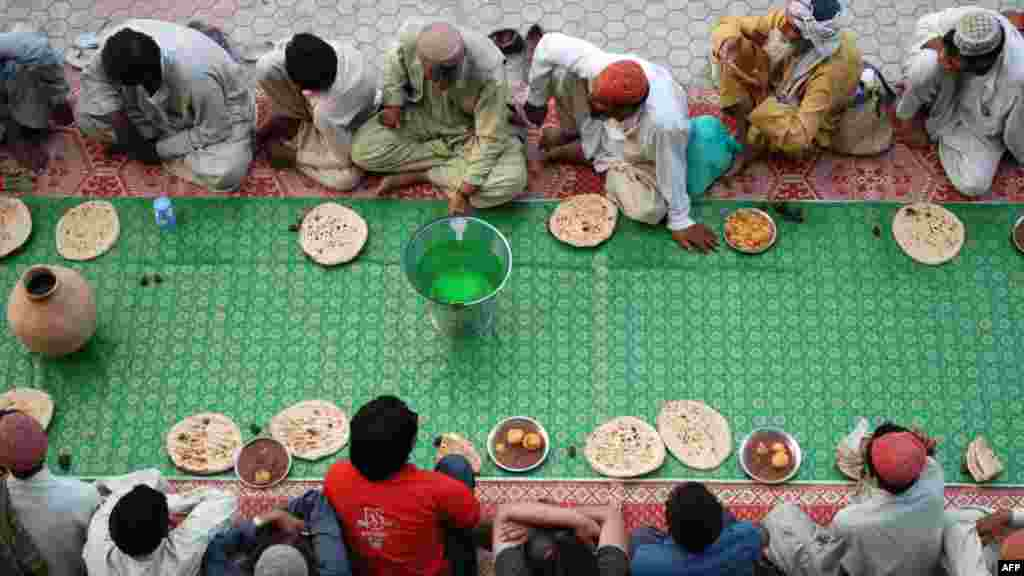 Pakistani Muslims wait to break their fast in Quetta on July 25. Muslims fasting in the month of Ramadan must abstain from food, drink, and sex from dawn until sunset, when they break the fast with the meal known as iftar. (AFP/Banaras Khan)