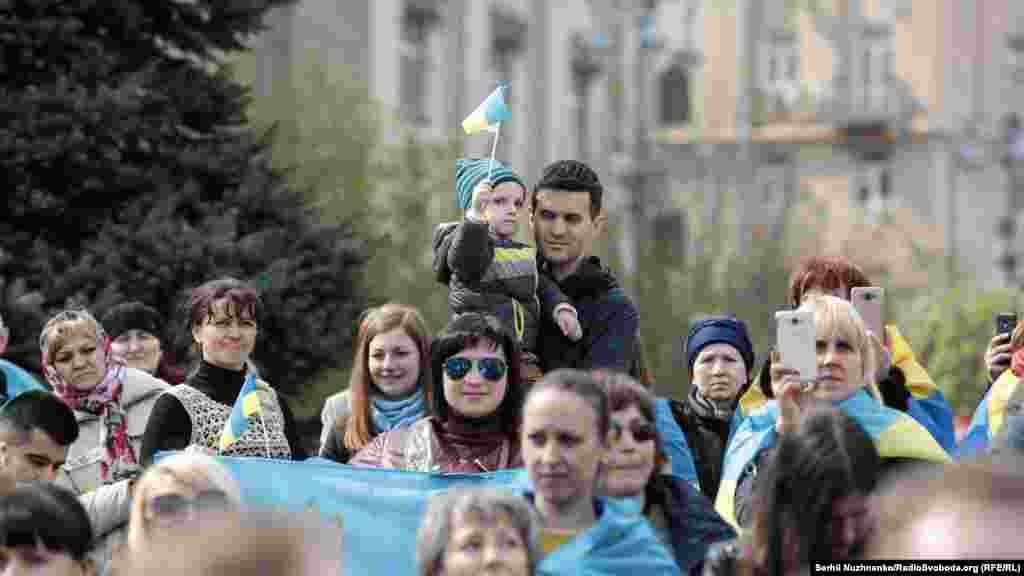Campaign activists carry Ukrainian flags...