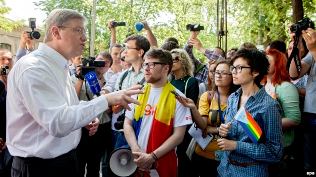 EU Commissioner for Enlargement and European Neighborhood Policy Stefan Fuele greets members of the LGBT community during a march for human rights in downtown Chisinau on May 19.