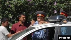 Armenia -- Traffic police fine a motorist.