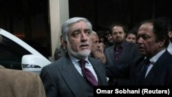 Afghan presidential candidate Abdullah Abdullah leaves a gathering after declaring victory on February 18.