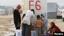 Сирийские беженцы в очереди за водой. Лагерь Аз-Заатри, Иордания