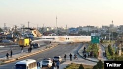 An Iranian airliner in the middle of city streets after it skidded off the runway at Mahshahr airport. January 27, 2020.