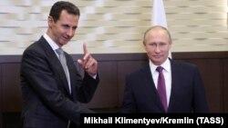 Сириянын президенти Башар Асад менен Орусиянын президенти Владимир Путин.