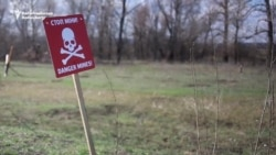 A Ukrainian Village Between Front Lines And Minefields