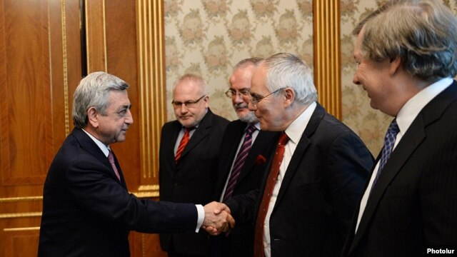Armenia - President Serzh Sarkisian (L) greets the visiting co-chairs of the OSCE Minsk Group, Yerevan, 16May2014.