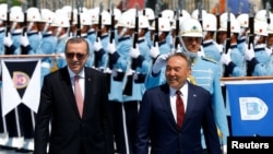 "Turkish President Recep Tayyip Erdogan (left) and his Kazakh counterpart, Nursultan Nazarbaev, at the Presidential Palace in Ankara in August 2016. Nazarbaev announced 11 Turkish teachers had been repatriated to Turkey in 2016 after their role in the failed coup had been ""proven."""