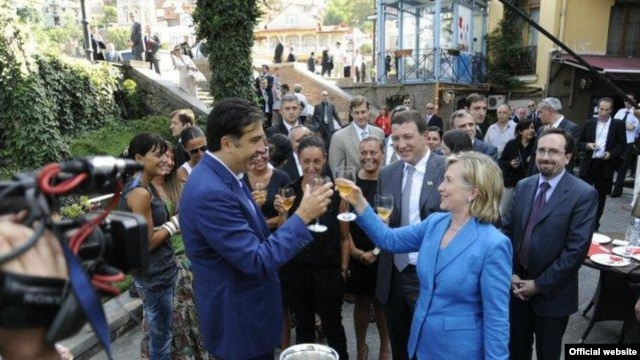 Georgian President Mikheil Saakashvili and U.S. Secretary of State Hillary Clinton toast good relations in Tbilisi in July.