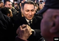 Former Macedonian prime minister and leader of the conservative VMRO-DPMNE party Nikola Gruevski celebrates elections results with supporters in Skopje on December 12.