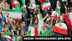 Iranian women cheer during the FIFA World Cup qualification match between Iran and Cambodia, at the Azadi stadium in Tehran, Iran 10 October 2019.