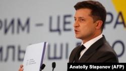 Ukrainian President Volodymyr Zelenskiy talks to reporters at the Crimean Platform summit in Kyiv on August 23.