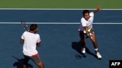 The doubles team of Rohan Bopanna (left) of India (left) and Aisam Ul-Haq Qureshi of Pakistan in their successful semifinal match at the U.S. Open tennis tournament in New York on September 8
