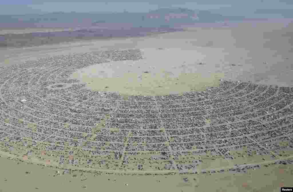 An aerial view of the Burning Man 2013 arts and music festival taken from high above the Black Rock Desert of Nevada.