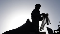 An Afghan soldier adjusts his weapon in Kabul on June 16.