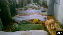 A video grab purportedly shows the bodies of men who were killed in a massacre in the central town of Tremseh.