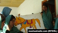 Students at CAI's Immit Higher Secondary School pose with some of their school work in April 2011.