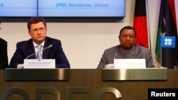 Russian Energy Minister Alexander Novak and OPEC Secretary-General Mohammed Barkindo address a news conference in Vienna on October 24.