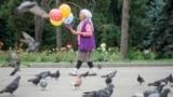 KAZAKHSTAN -- An elderly woman sells balloons in a park in Almaty, Kazakhstan June 28, 2017