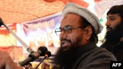 Pakistani head of the banned organisation Jamaat-ud-Dawa Hafiz Saeed addresses a gathering during a protest rally in Muzaffarabad, the capital of Pakistan-administered Kashmir, on February 3.