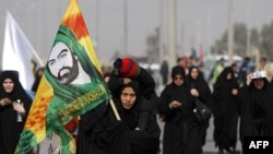 Shi'ite pilgrims leave Baghdad for the holy city of Karbala on February 1, when a female suicide bomber killed more than 40 and wounded over 100 other pilgrims.