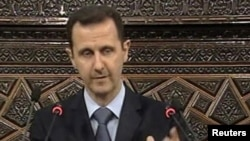Syria -- A TV grab shows President Bashar Al-Assad addressing the parliament in Damascus, 30Mar2011