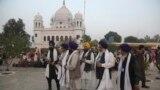 FILE: Indian Sikh pilgrims visit Gurdwara Darbar Sahib, the shrine of their spiritual leader Guru Nanak Dev in Kartarpur.