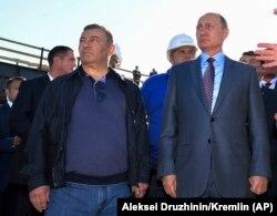 Президент Владимир Путин и Аркадий Ротенберг на строительстве Керченского моста, 15 сентября 2016 года