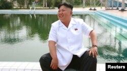 Лидер Северной Кореи Ким Чен Ын. Фото, распространенное официальным информационным агентством страны 6 июля 2014 года.
