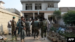 Afghan security forces inspect the site of a suicide bombing that targeted a gathering of the local tribal elders in the Chaparhar district of Nangarhar Province on October 31.