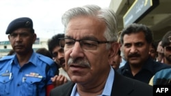 Pakistan -- Pakistani Defense Minister Khawaja Asif talks to media as Pakistani citizens evacuated from Yemen arrive at Benazir International Airport in Islamabad, April 3, 2015