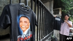 A man sells T-shirts picturing U.S. President Barack Obama outside a primary school in Jakarta, Indonesia.