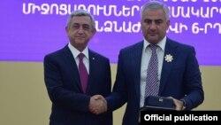 Armenia - President Serzh Sarkisian (L) awards a state medal to Russian-Armenian businessman Samvel Karapetian, Yerevan, 26Sep2015.