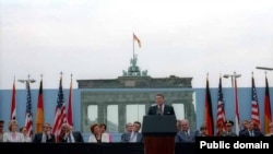 U.S. President Ronald Reagan speaks in front of the Brandenburg Gate and the Berlin Wall on June 12, 1987.