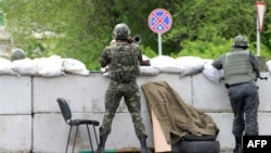 A Ukrainian soldier holds a rocket launcher as he guards a checkpoint near the eastern city of Slovyansk on May 5.