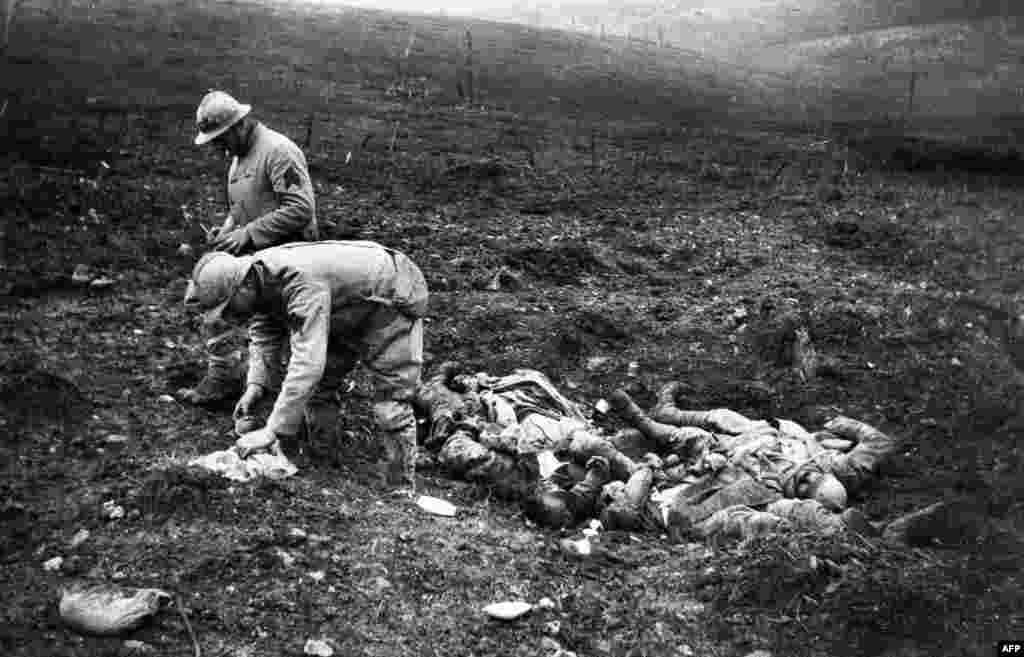 French soldiers collect the bodies of dead comrades in Verdun, France on October 1, 1917.