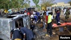 Нигерия қауіпсіздік күштері теракт болған жерде жүр. Кано, 24 ақпан 2015 жыл. (Көрнекі сурет)