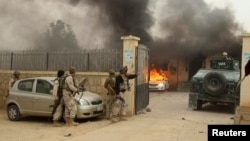 Afghan security forces arrive at the site of an attack in Kunduz province on October 27, 2014.