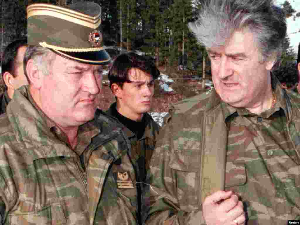 Mladic and former Bosnian Serb leader Radovan Karadzic talk to each other on the Vlasic Mountain in 1995.