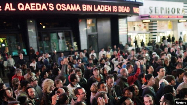 People gather in New York's Times Square as news of Al-Qaeda leader Osama bin Laden's death in Pakistan is announced on May 2.