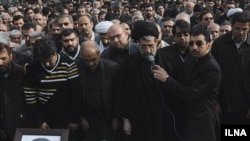 Mourners at the funeral of Masud Ali Mohammadi in Tehran on January 14