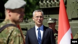 NATO Secretary-General Jens Stoltenberg attends an inauguration ceremony for a Canadian-led NATO battalion in Latvia.