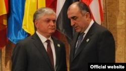 Armenia's Edward Nalbandian and Azerbaijan's Elmar Mammadyarov meet on the sidelines of a NATO summit in Lisbon in November 2010.
