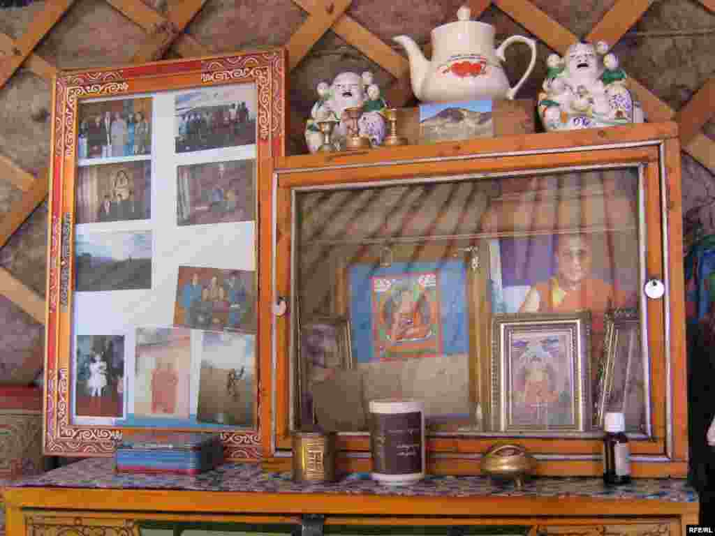 A family shrine in a Mongolian ger. - Mongolian nomads keep possessions to a minimum, but every ger includes a small, brightly colored shrine that mixes family photographs with prayer wheels, incense burners, and Buddhist figurines. Life in gers is conducted according to standard rules and traditions. First-time visitors must enter to the left, and only move within the ger in a clockwise direction. Family elders and respected visitors occupy the right side of the ger.