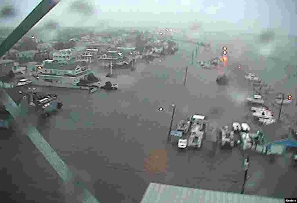 U.S.Coast Guard Station Barnegat Light, New Jersey, and the surrounding area is shown flooded in this handout photo supplied by the U.S. Coast Guard as Hurricane Sandy moves into the area.