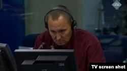 Franc Kos svjedoči na suđenju Radovanu Karadžiću, 1. kolovoz 2013.