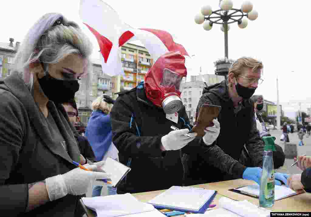 Activists wearing protective masks and gloves gather signatures in support of their potential candidates in the upcoming presidential elections in Minsk on June 14.